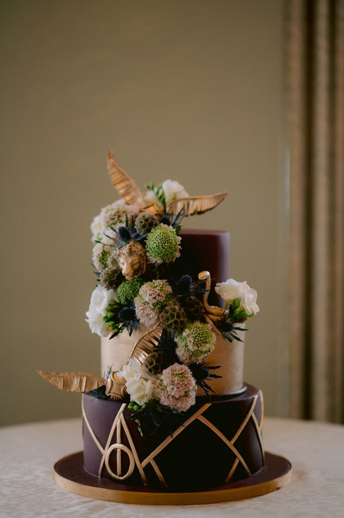 Harry Potter wedding cake with Deathly Hallows, Golden Snitches and Gryffindor and Slytherin