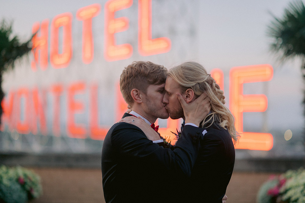 Grooms Kiss On The Hotel Monteleone Rooftop In New Orleans