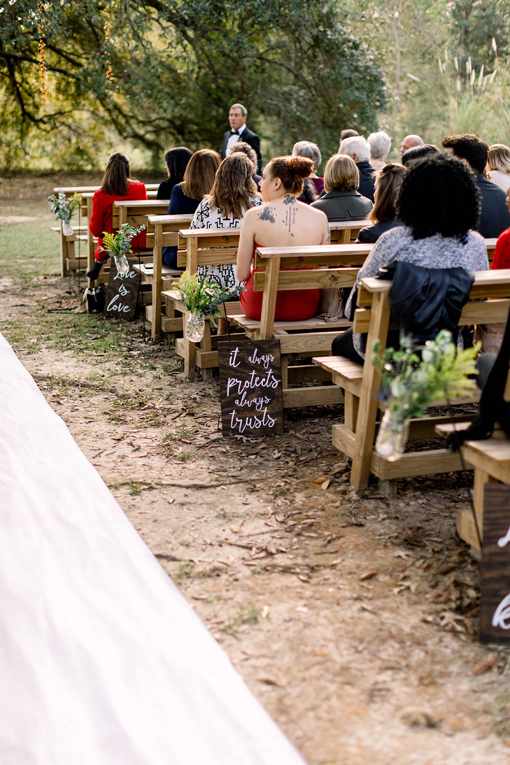 the wedding aisle lined with signs 1 Corinthians 13