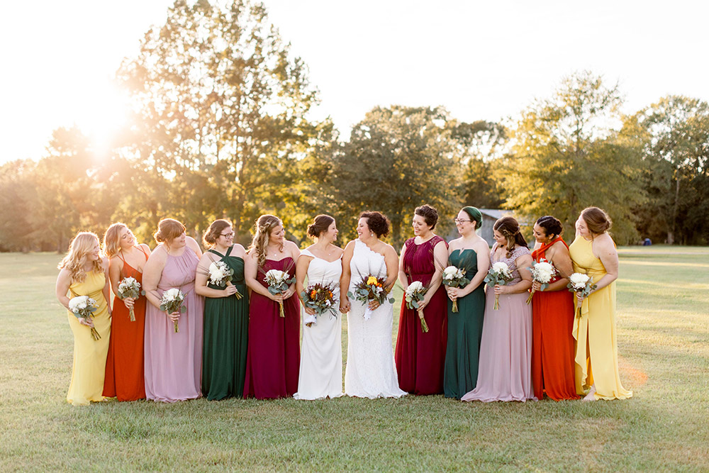 the brides and bridesmaids' in a fall rainbow of color