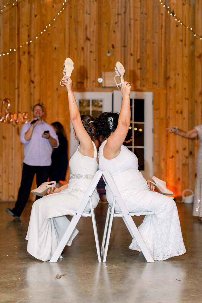 the brides play the shoe game at the wedding reception
