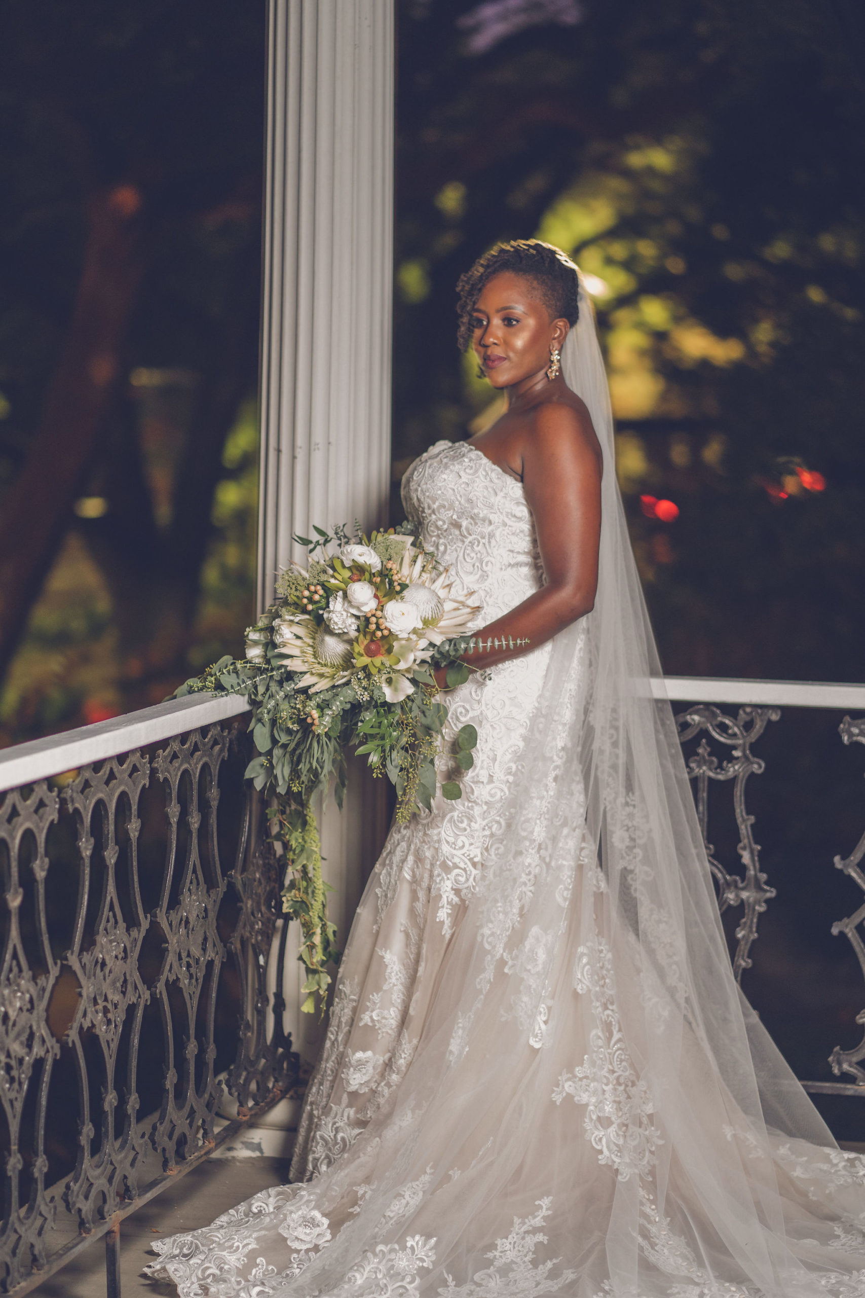 Bride on New Orleans balcony XXI Facets Photography