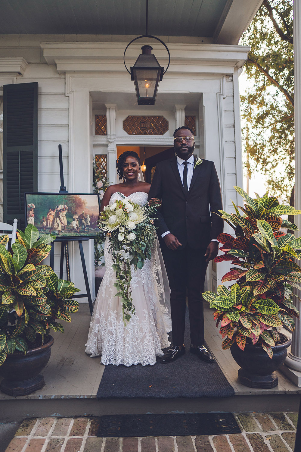 bride with tropical wedding bouquet
