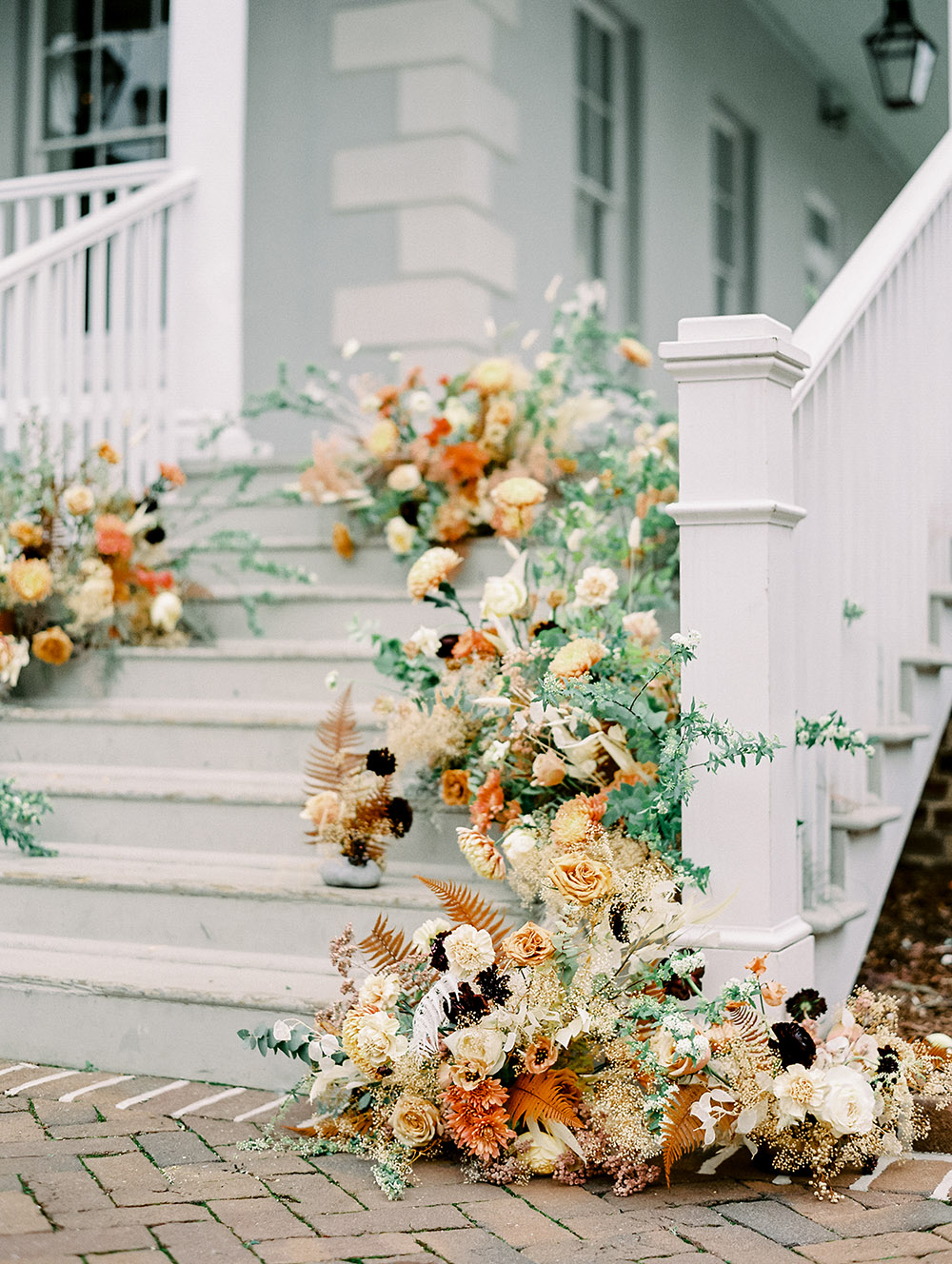 Juniper & Jasmine Floral Design created lush floral arrangements within Pure Luxe Bride's neutral, terracotta color palette for this editorial.