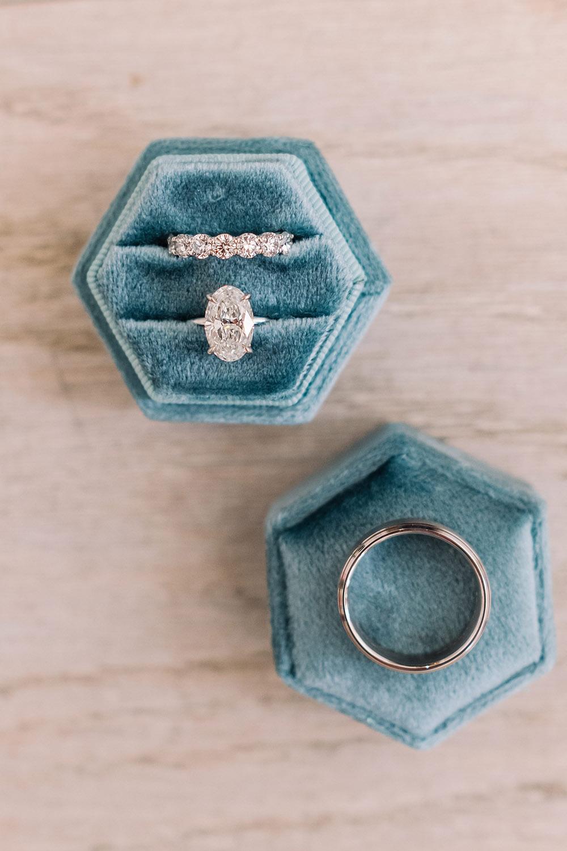 wedding rings in a blue velvet box