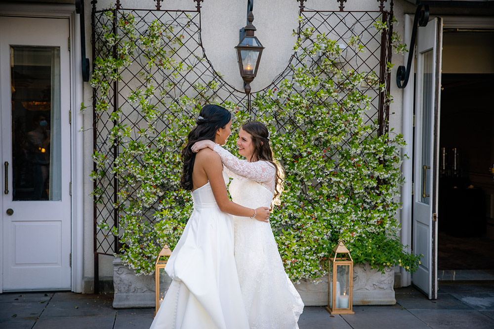 """""""We love musicals,"""" Emily and Rachel share, """"and one of our favorite moments from the wedding is when the DJ played """"Helpless"""" from Hamilton. Everyone sang and danced, and we could really feel the joy and love filling the room."""""""